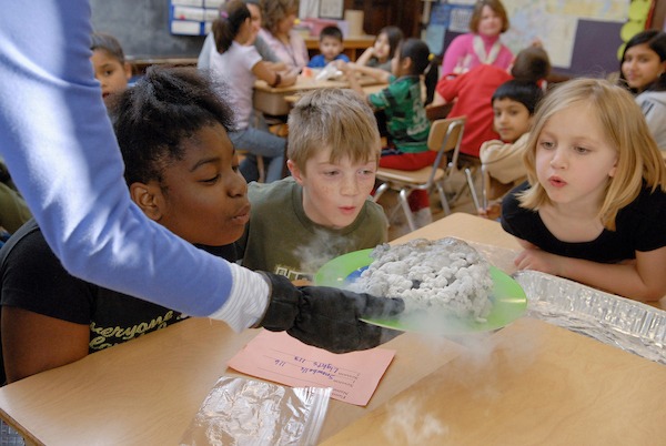 Kay Kriewald, an outreach specialist at UW-Madison Space Place, uses a combination of solids, liquids and dry ice to teach children about the properties of comets during Science Night at Emerson Elementary School in Madison, Wis., on April 17, 2007. The event was sponsored by the University of Wisconsin-Madison's Center for Biology Education and involved several outreach presentations by UW-Madison experts.