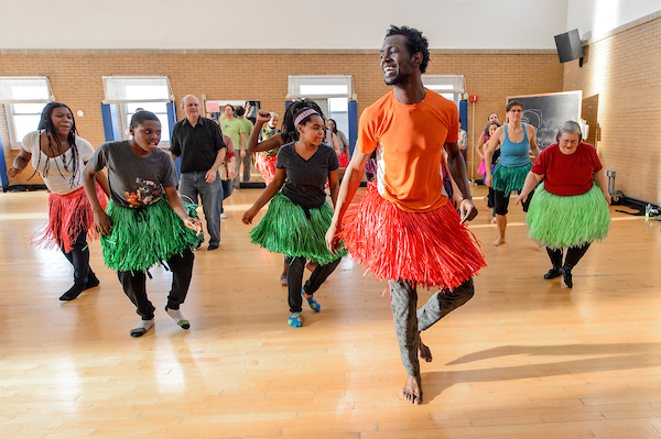 """Dancers participate in a Brooklyn Jumbies workshop in Lathrop Hall at the University of Wisconsin-Madison on Feb. 28, 2015. The workshop was hosted by the UW-Madison Arts Institute as part of Laura Anderson Barbata's spring interdisciplinary arts residency. Participants worked with the Brooklyn Jumbies, a dance performance group that teaches stilt walking, and Chris Walker, UW associate professor of dance, to learn new dance moves in preparation for """"Strut!"""" — a UW-Madison dance event scheduled for May 2, 2015. (Photo by Bryce Richter / UW-Madison)"""