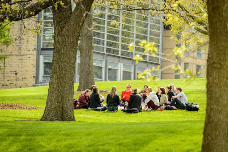 A class meets for an outdoor session on Bascom Hill at the University of Wisconsin-Madison.