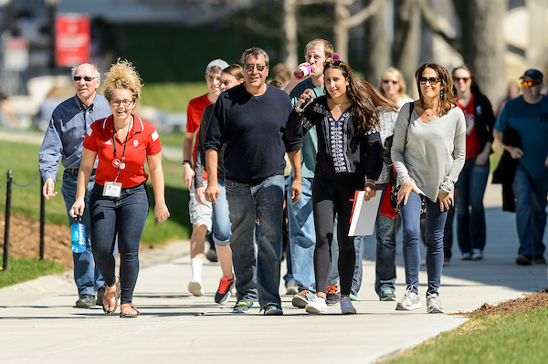 A tour group walks on campus in summertime