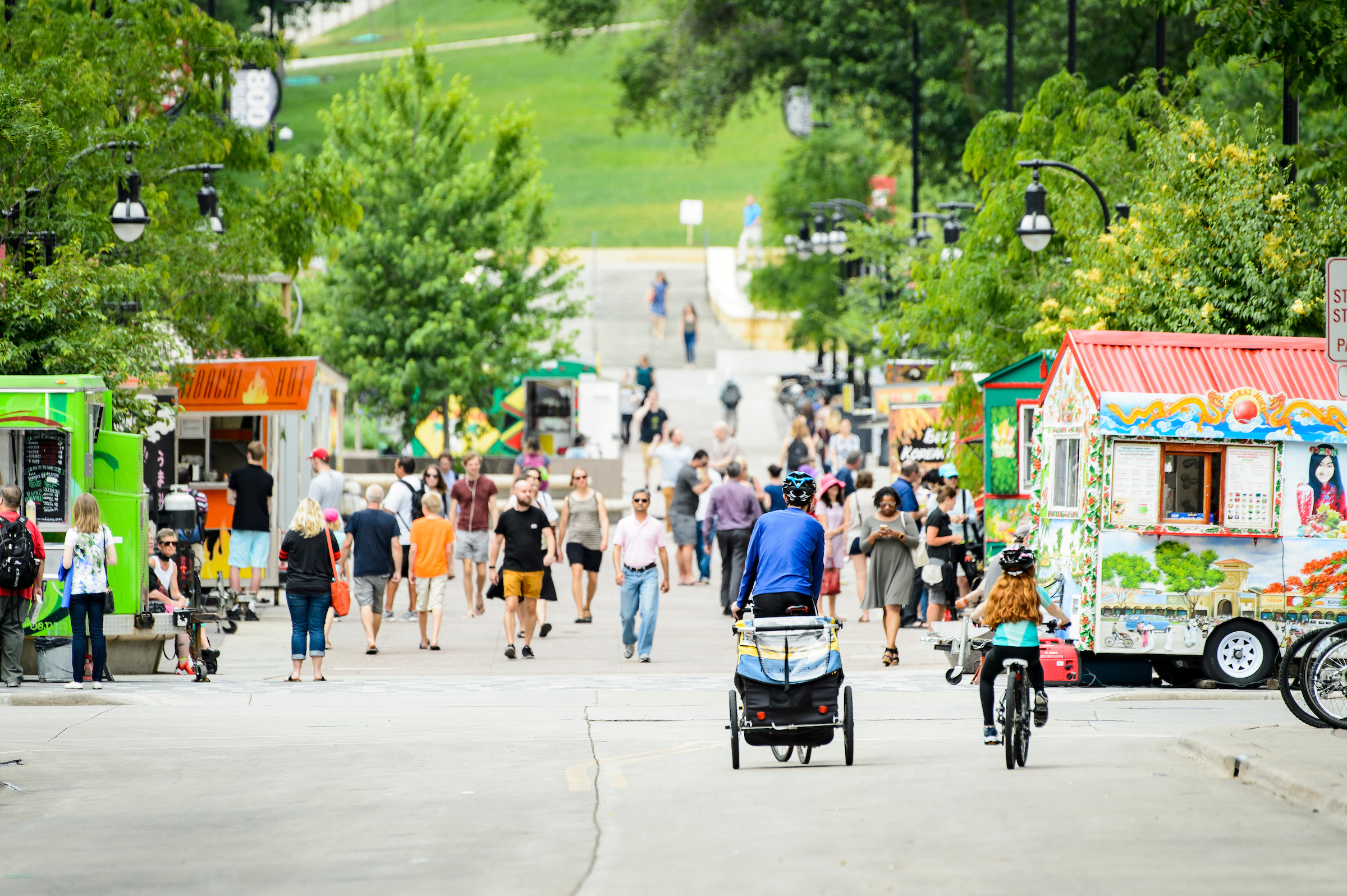 Pedestrians and lunchtime patrons walk amongst the food carts on Library Mall at the University of Wisconsin-Madison on June 13, 2017. (Photo by Bryce Richter / UW-Madison)