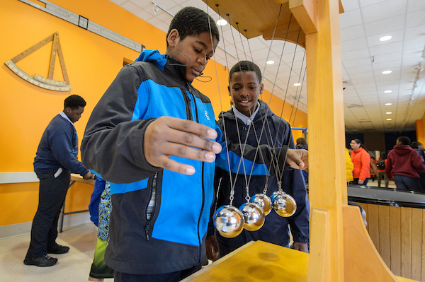 Students from the Milwaukee Excellence Charter School, including John Hayes (left), take a tour of the L.R. Ingersoll Physics Museum in Chamberlin Hall during a Bucky's Classroom event at the University of Wisconsin-Madison.