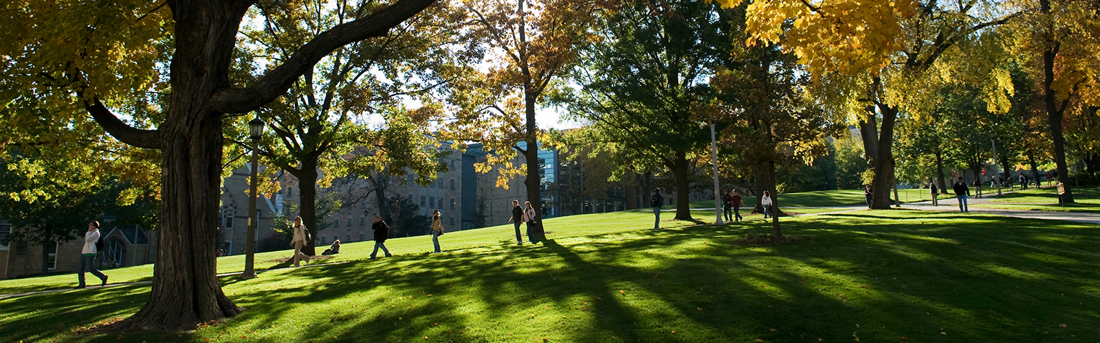 Pedestrians walk down Bascom Hill at the University of Wisconsin-Madison during a sunny autumn day
