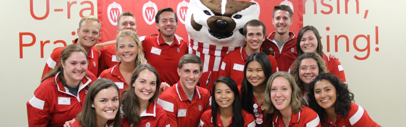 Information and Tour Guides pose with Bucky at the Sunburst Festival.