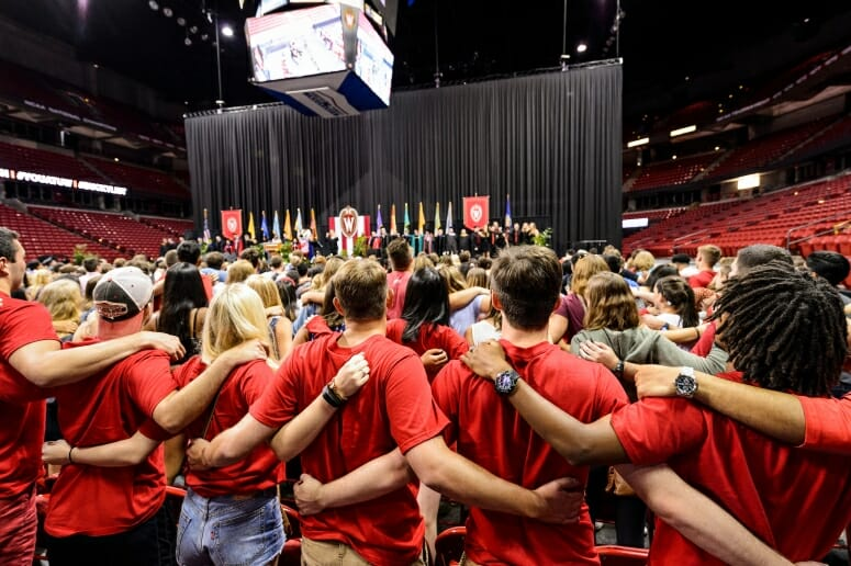 First-year students link arms and sing