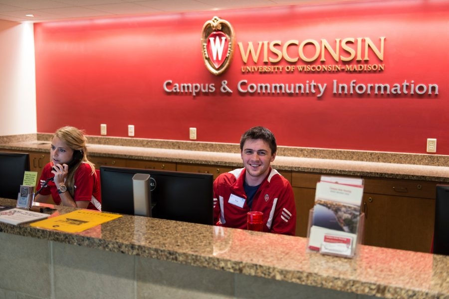 A staff member answers a phone question at the campus and community information desk at the Memorial Union.