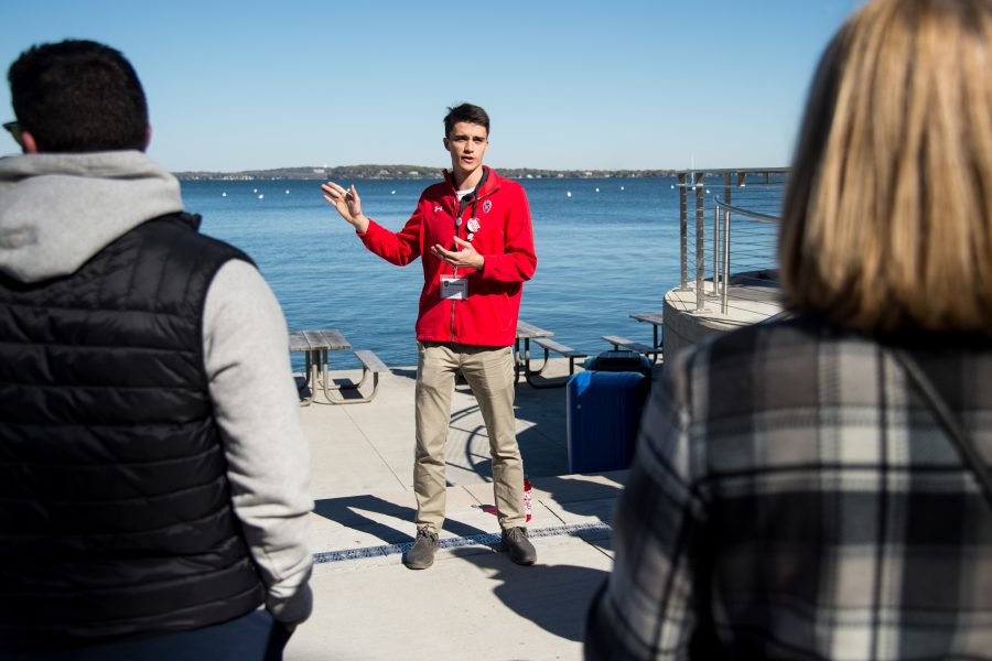 Student Tour Guide showing prospective students and guests Lake Mendota, pictured in the background, while standing on the Memorial Union Terrace.