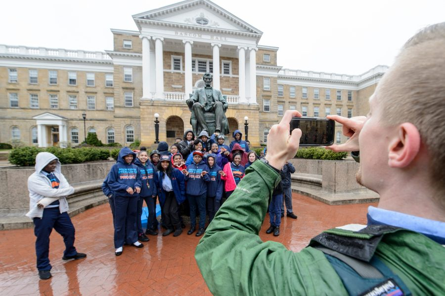 Students from the Milwaukee Excellence Charter School take a group photo during a tour of Bascom Hill.