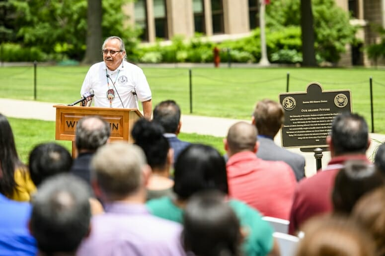 "Wilfrid Cleveland, president of the Ho-Chunk Nation, speaks to members of the Ho-Chunk Nation and UW–Madison community members during the June 18 dedication ceremony for the ""Our Shared Future"" heritage marker on Bascom Hill."